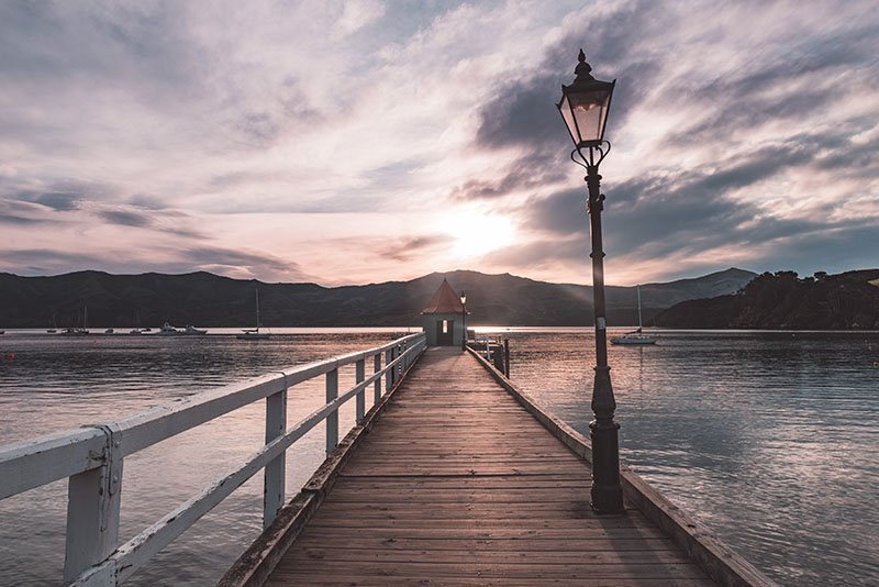 Akaroa is a small town off the beaten track in New Zealand. Find out why you should visit it!