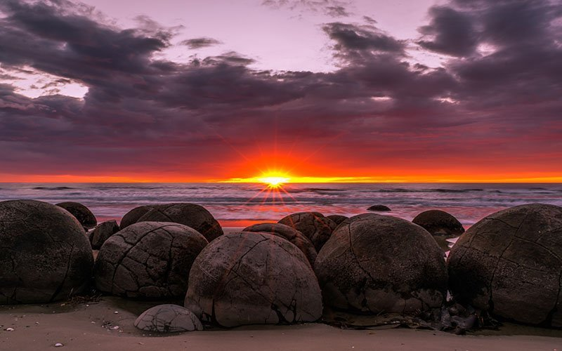 The Moeraki Boulders are one of the world's most magical places. Find this beauty in New Zealand's South Island!