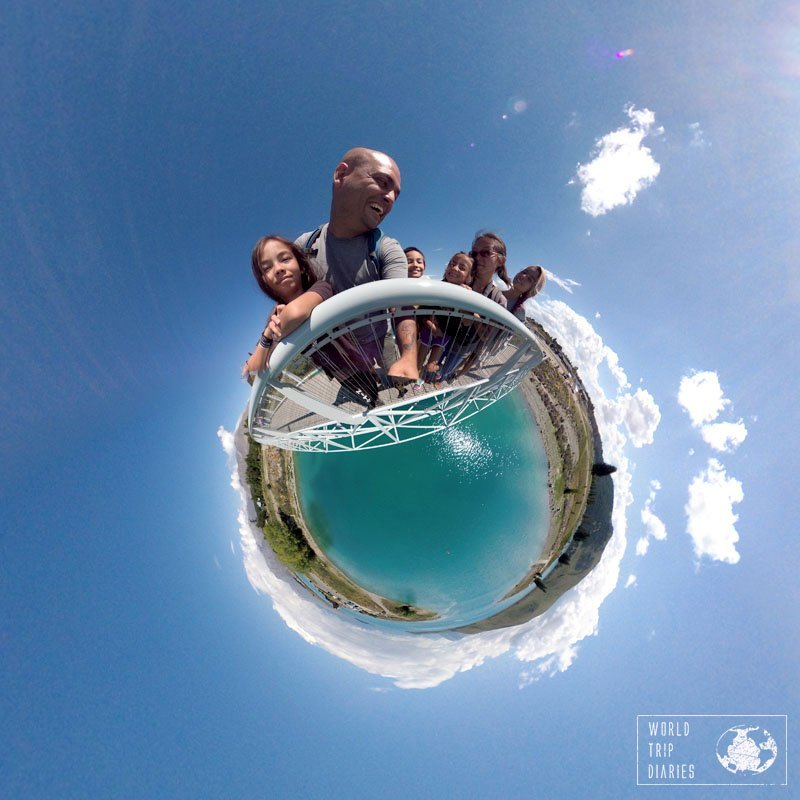 A tiny planet photo with the 6 of us on the planet, holding on a rail, and the blue waters of Lake Tekapo (NZ) on the bottom. Taken with the Garmin Virb.