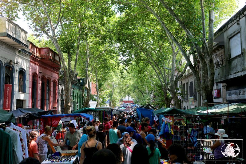 A very busy street lined with stalls and colonial houses in Montevideo, Uruguay. This street fair happens every weekend and it's endless!