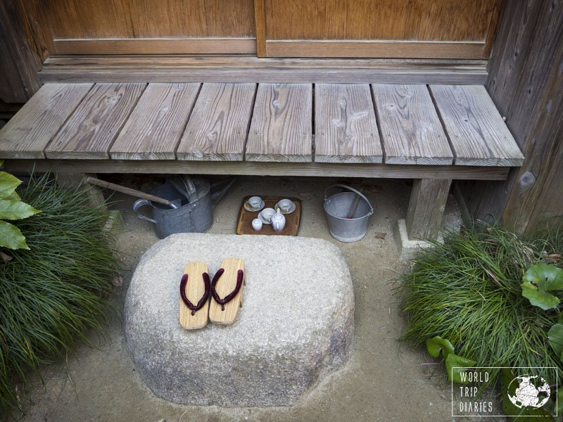 The outside deck with sandals on a rock and a tea set + gardening tools under the deck. It was a great day to also learn how the Japanese in the 80's lived. A visit to Satsuki and Mei's house is a must!