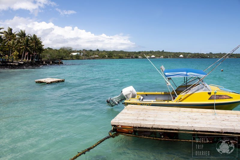 A platform on the foreground, followed by a yellow boat on the bright blue waters of Savai'i. If this isn't the life to live, I don't know what is!