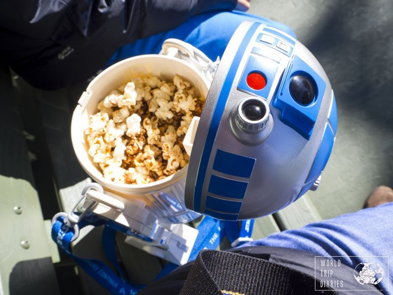 Tokyo Disney offers the best buckets for the popcorn sold at the parks. We were torn between getting the R2D2 or the BB8, but the R2 was closer. Click to know more!