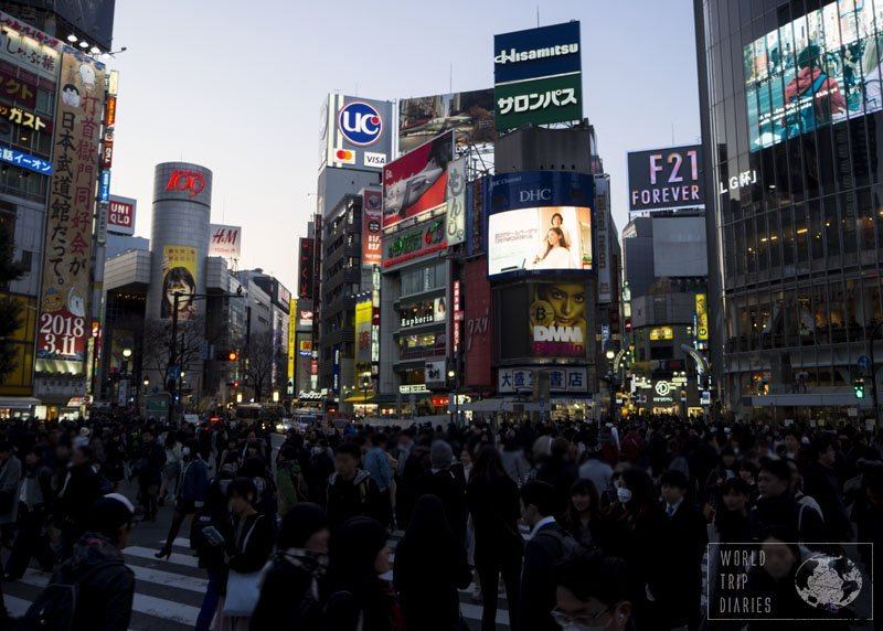 Shibuya crossing, full with people, and surrounded by buildings. That's Japan!