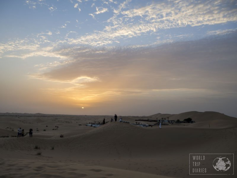 The sunset over the dunes of Abu Dhabi. It didn't have the reflections on the water, but it was just as incredible! Watching it from the top of a dune with my kids was a great moment!