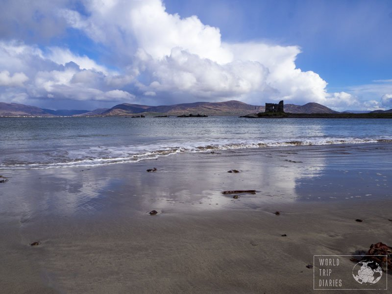 Ballinskellig Bay with the shallow waters reflecting the clouds and the blue skies, and the castle ruins at the back. Castle ruins are even more romantic than the actual well kept castles, aren't they? The UK is full of them!