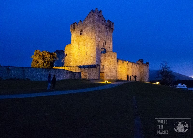 Ross Castle, in Ireland, at night. The sky is a royal blue and there are spotlights lighting the castle. We weren't even going to stop there, but I'm glad we did. We had lots of fun.