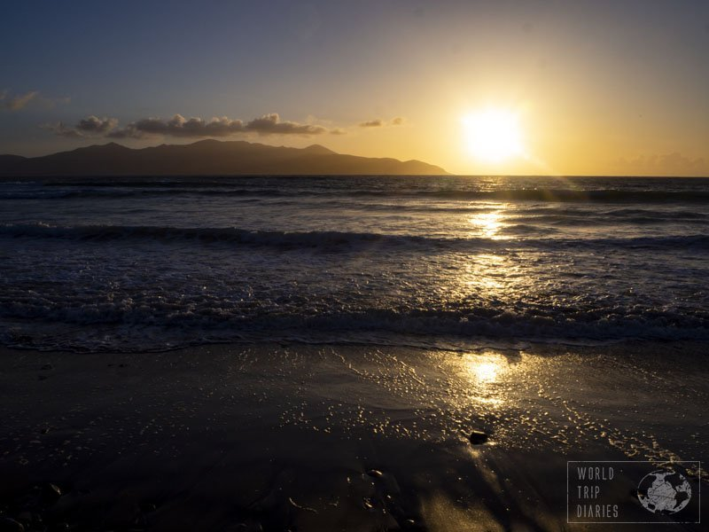 The sun setting over the sea of Castlegregory Beach, in Ireland. It's a lovely rocky beach with various water sports options. Click for more!