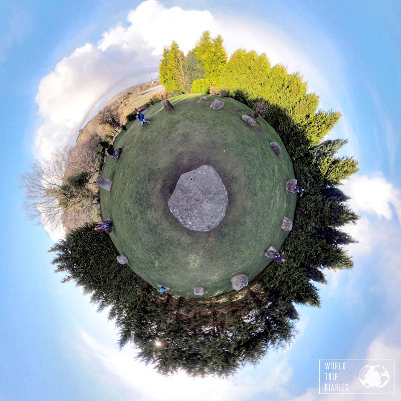 The Stone Circle of Kenmare, Ireland. A tiny planet, with trees on the edges, a large boulder in the middle, and 14 stores forming a circle around it. Click for more!