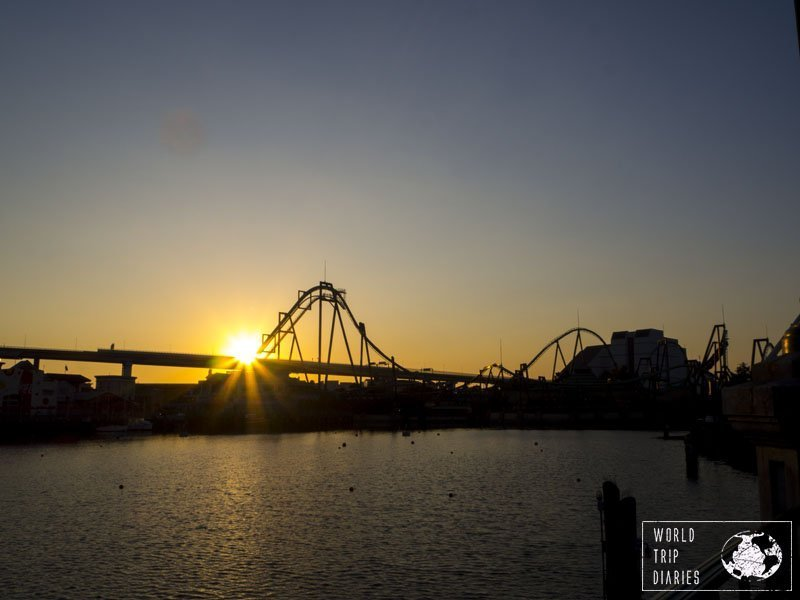 The sun setting behind a roller coaster at Universal Studios Japan. We always stop there to appreciate the view of the sunset against the silhouette of the roller coaster!
