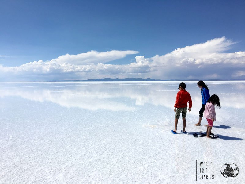 The kids walking on the clouds in Uyuni Salt Flats. Bolivia is, definitely, a country to visit with the family!