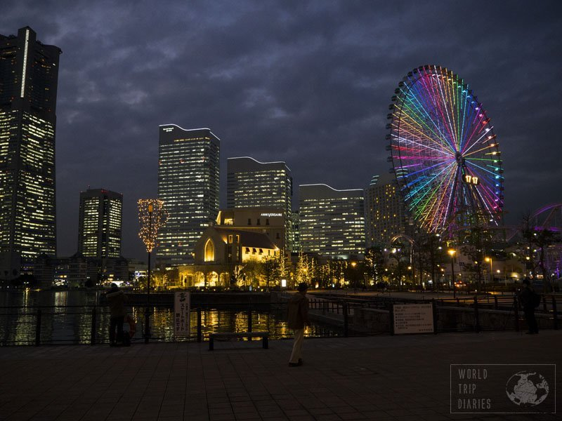 Minato Mirai at night: the buildings have their lights on and the Ferris wheel is all rainbow colors. Yokohama is prettier at night!